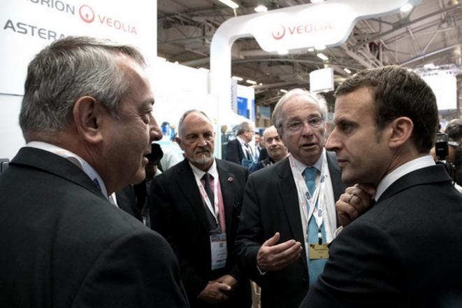 Antoine Frérot et Emmanuel Macron lors du salon World Nuclear Exibition. © Capture du site de Veolia