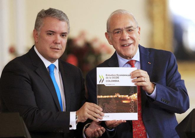Iván Duque y el secretario general de la OCDE, Ángel Gurría, en Bogotá en 2019. © AFP