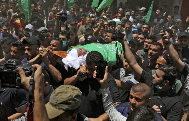 Enterrement le 13 mai 2021 d'un dirigeant du Hamas tué dans une frappe israélienne à Gaza. © Mahmud Hams/AFP