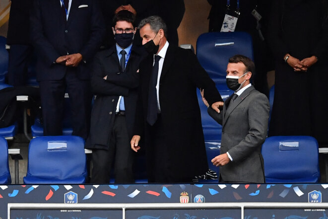 Nicolas Sarkozy et Emmanuel Macron, le 19 mai 2021, au Stade de France, pour la finale de la Coupe de France de football. © Franck Fife / AFP