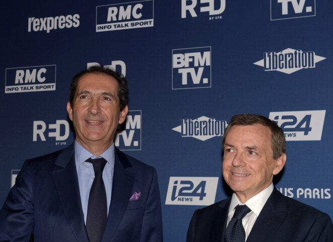 Patrick Drahi, fondateur d'Altice, et Alain Weill, responsable d'Alice France à l'époque, en octobre 2018. © Éric Piermont/AFP