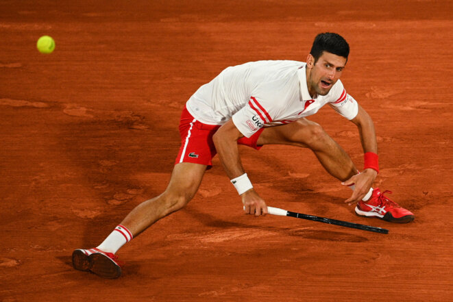 Novak Djokovic, lors d'un match face à Rafael Nadal. © Anne-Christine POUJOULAT / AFP