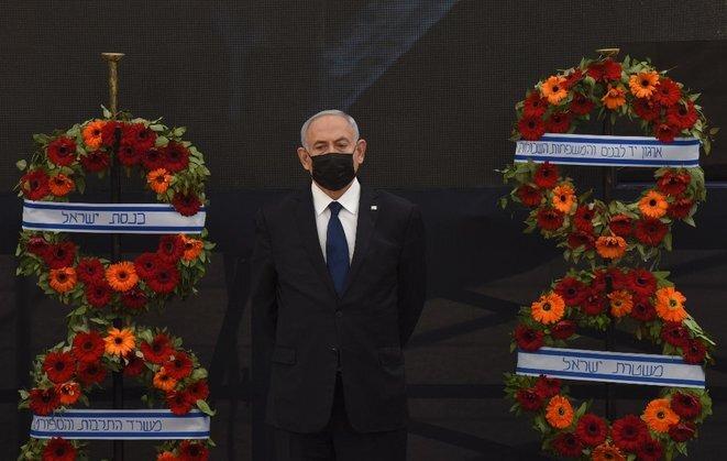 Benjamin Netanyahu en una ceremonia en memoria de soldados el 13 de abril de 2021 en Jerusalén. © Debbie Hill/Pool/AFP
