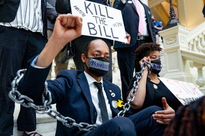 Des manifestants contre la loi restreignant le vote en Georgie, le 8 mars 2021 à Atlanta. © Megan Varner/Getty Images North America/AFP