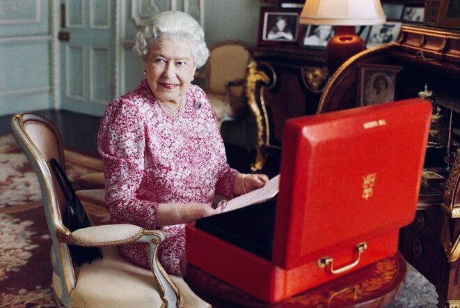 Queen Elizabeth II is seated at her desk in her private audience room at Buckingham Palace with one of her official red boxes which she has received almost every day of her reign and contain important papers from government ministers in the United Kingdom and her Realms and from her representatives across the Commonwealth and beyond. (July 2015) © Mary McCartney