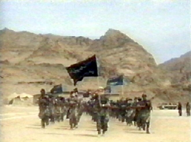 Screen grab from June 19th 2001 showing members of Al Qaeda marching at a training camp in Afghanistan. © HO/AFP