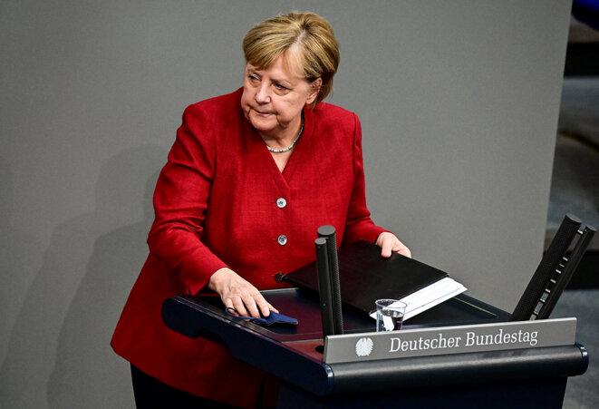 La chancelière allemande, Angela Merkel, à la fin de son discours devant le parlement allemand à Berlin, le 25 août 2021. © Photo Tobias Schwarz / AFP