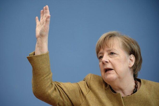 Angela Merkel lors d'une conférence de presse en février 2021. © Michael Kappeler  / AFP