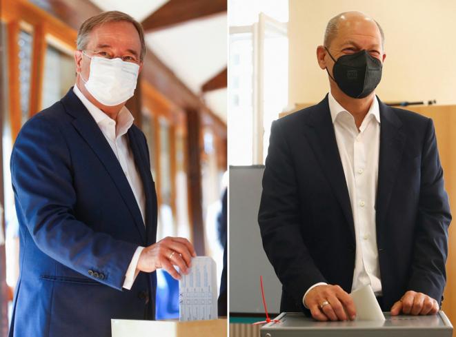 Armin Laschet (CDU) et Olaf Scholz (SPD), au moment de voter aux éléctions législatives, ce dimanche 26 septembre. © WOLFGANG RATTAY, THILO SCHMUELGEN / POOL / AFP