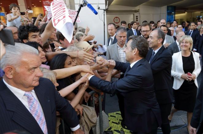 Nicolas Sarkozy devant l'UMP le 8 juillet 2013, pour le lancement du Sarkothon