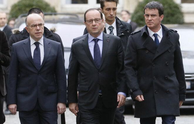 Bernard Cazeneuve, François Hollande et Manuel Valls. © Reuters