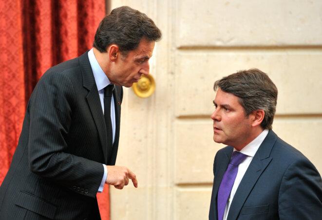 Nicolas Sarkozy et Franck Louvrier, en mai 2010.