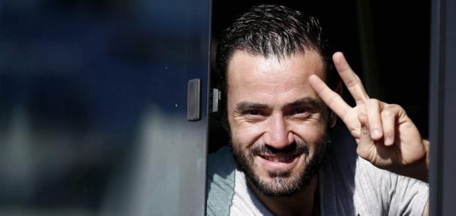 [Un réfugié syrien débarque au Pirée (Grèce), vendredi 11 septembre. © Reuters