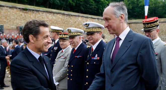 Nicolas Sarkozy et Philippe Courroye. © Reuters
