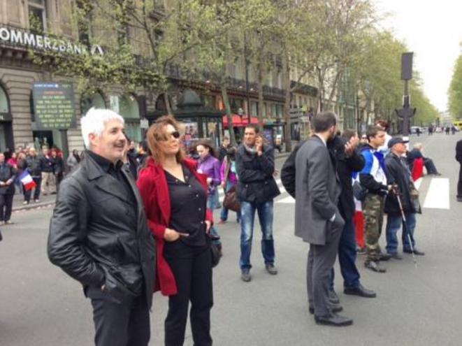 Philippe Péninque écoutant le discours de Marine Le Pen, le 1er Mai 2013, place de l'Opéra, à Paris.