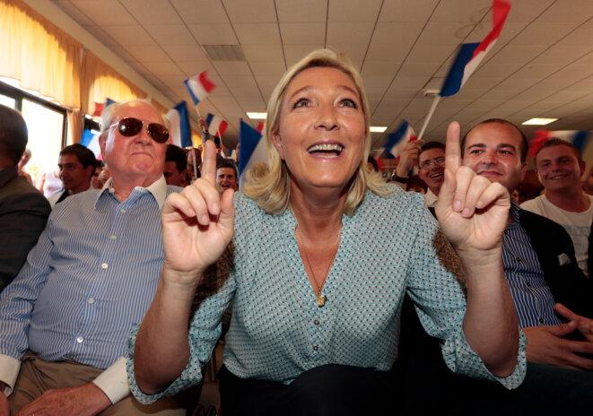 Jean-Marie Le Pen, Marine Le Pen et le maire de Fréjus David Rachline, le 7 septembre, lors de l'université d'été du FNJ. © Reuters