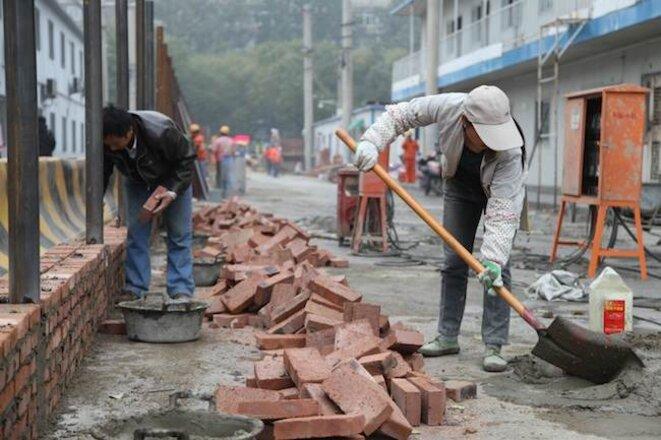 Ouvriers sur un chantier, à Pékin