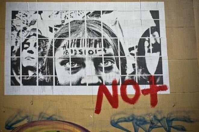 Un affiche sur le mur de l'Université du Chili. © Thomas Cantaloube