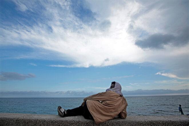 Un migrant originaire d'Erythrée à la frontière entre Vintimille et Menton le 14 juin 2015. © Eric Gaillard/Reuters