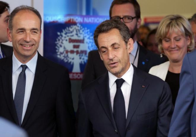 Jean-François Copé y Nicolas Sarkozy, julio 2013. © Reuters