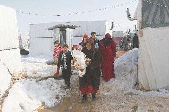 Sirios en un campo de refugiados situado en el valle de la Becá. © Reuters