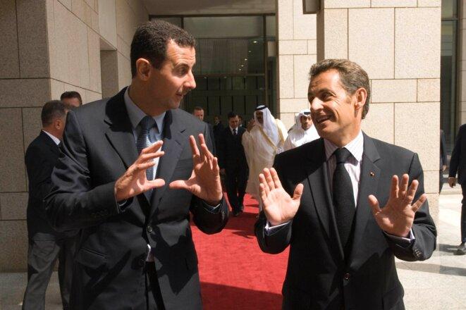 MM. Assad et Sarkozy © Reuters