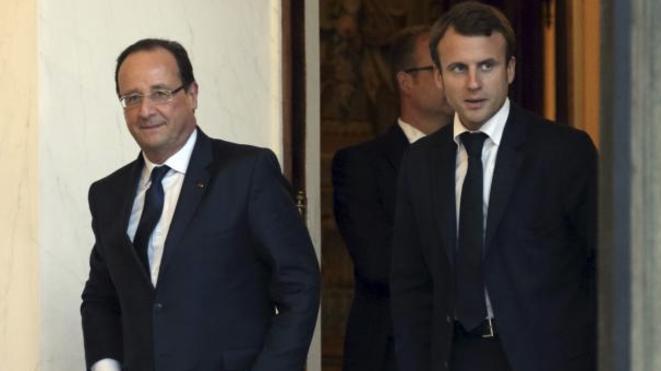François Hollande et Emmanuel Macron, secrétaire général adjoint de l'Elysée. © Reuters