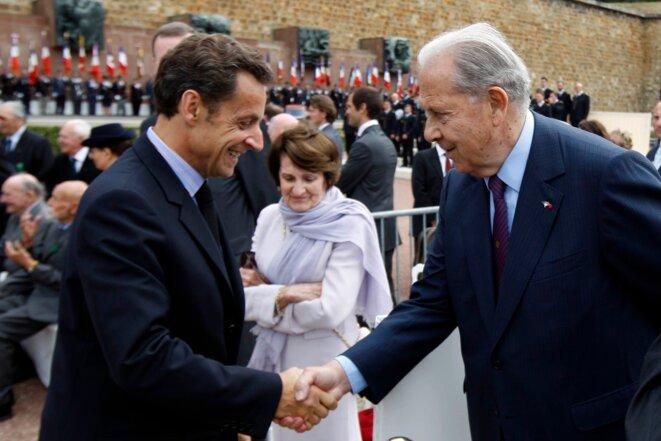 MM. Sarkozy et Pasqua, tous deux anciens ministres de l'intérieur.