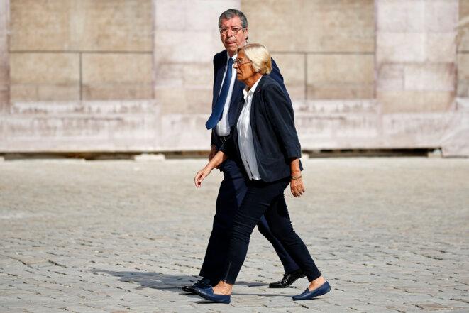 Patrick et Isabelle Balkany, le 2 juillet, aux obsèques de Charles Pasqua.  © Reuters