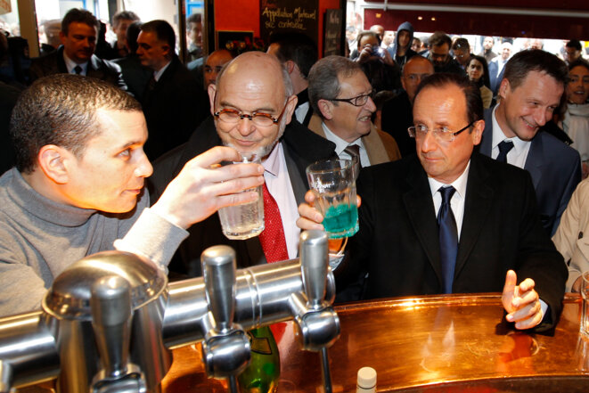 Robert Hue et François Hollande en avril.