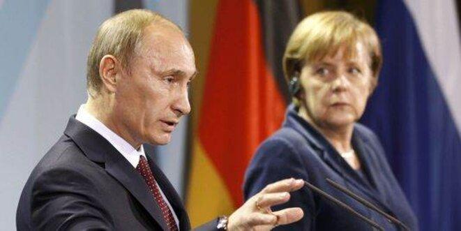 Vladimir Poutine et Angela Merkel.