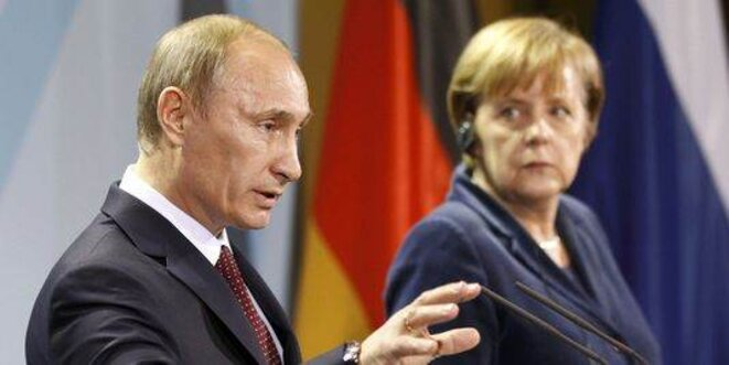 Vladimir Poutine et Angela Merkel © Reuters