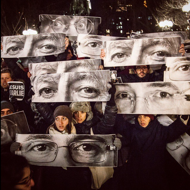 Les regards de Charb, Wolinski et Cabu le 9 janvier dans les rues de New York (photo par Marc Azoulay) © JR