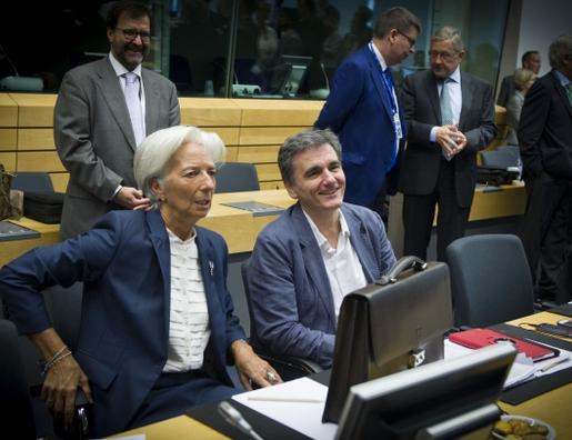 Christine Lagarde, présidente du FMI, et Euclide Tsakalotos, ministre des finances grec, dimanche à Bruxelles.